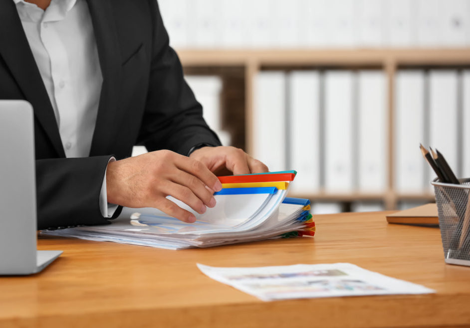 99236025 - young man working with documents in office